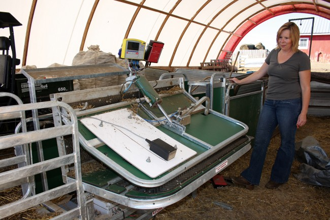 Debbie demonstrates new Racewell handling system. Photo by Tracy Hagedorn